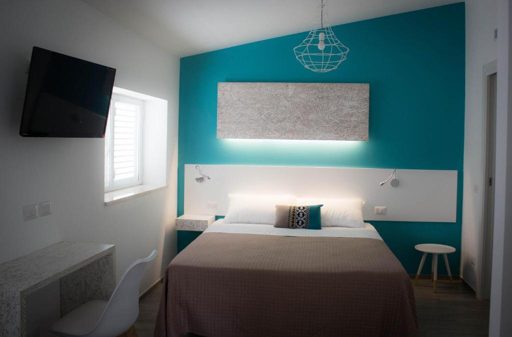 A bed or beds in a room at I MURETTI A SECCO B&B