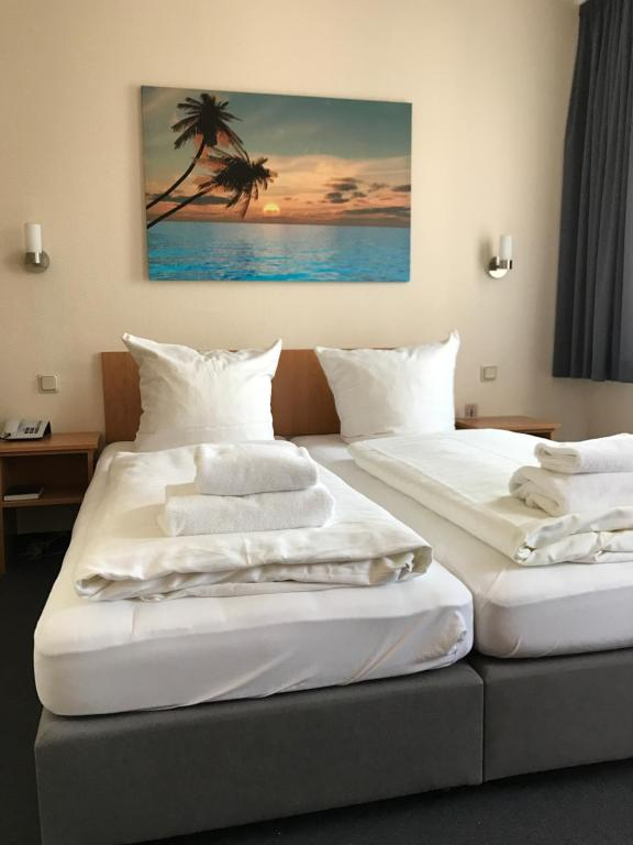 A bed or beds in a room at Hotel La Isla