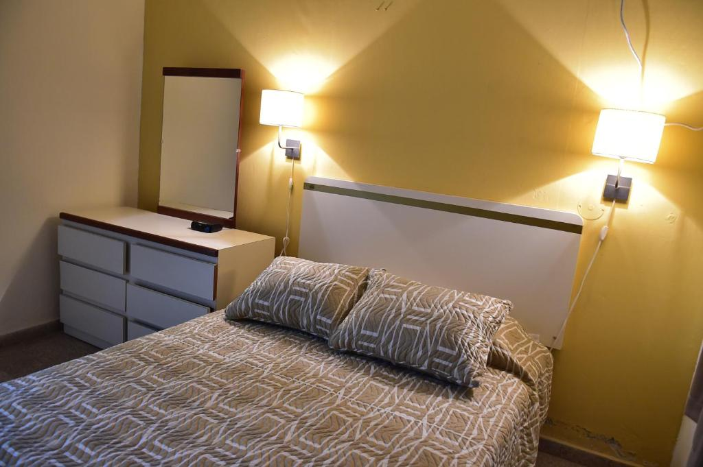 A bed or beds in a room at Hostal Universitario