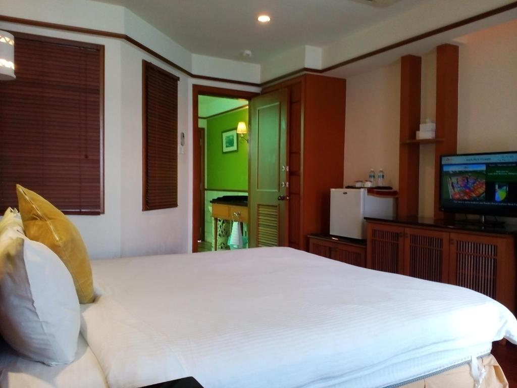 A bed or beds in a room at Wonderland Private Chalet at Port Dickson