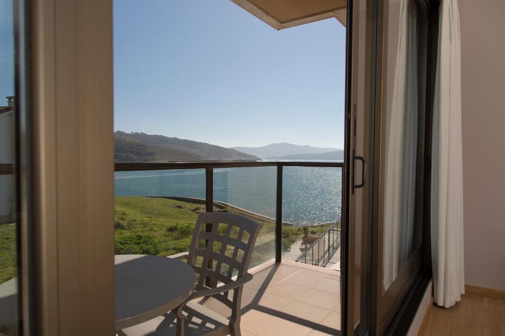 Foto del Apartamentos Turísticos Playa de Osmo