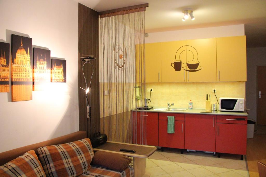 A kitchen or kitchenette at Green Frog apartment