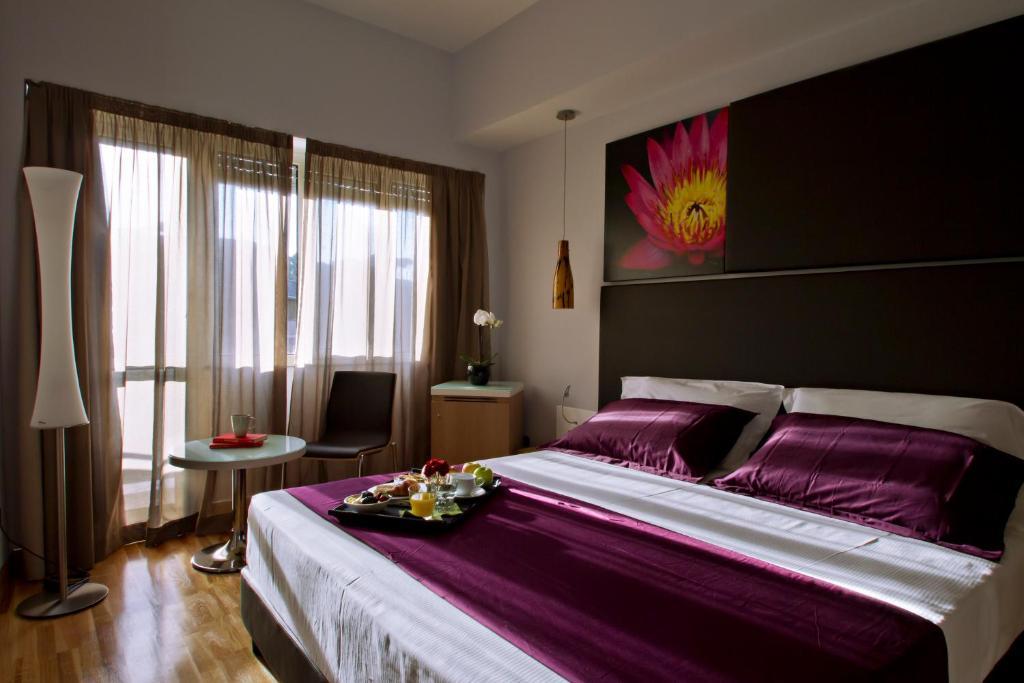 Кровать или кровати в номере Hotel Gravina San Pietro