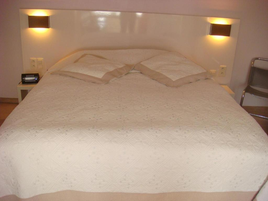 Ein Bett oder Betten in einem Zimmer der Unterkunft B&B Centersuites