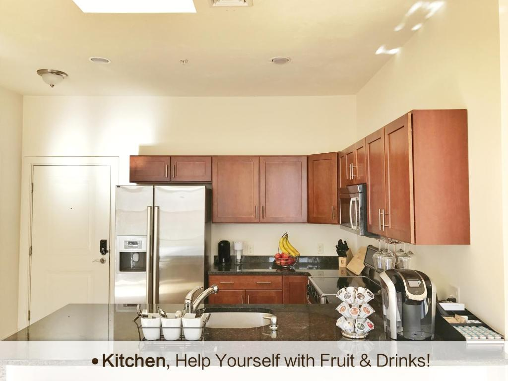 A Kitchen Or Kitchenette At Two Bedroom Boston Luxury Apartment
