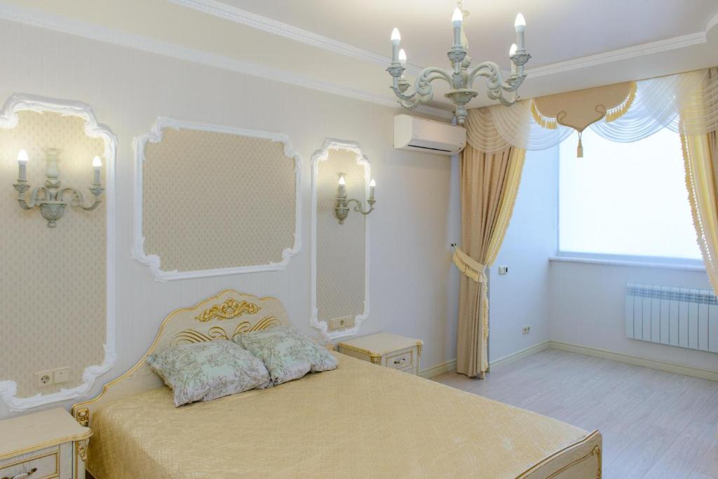 Кровать или кровати в номере Володарского, 157