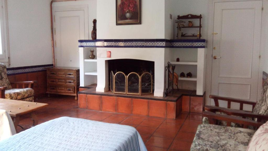 A bed or beds in a room at casa chalet El Sotillo