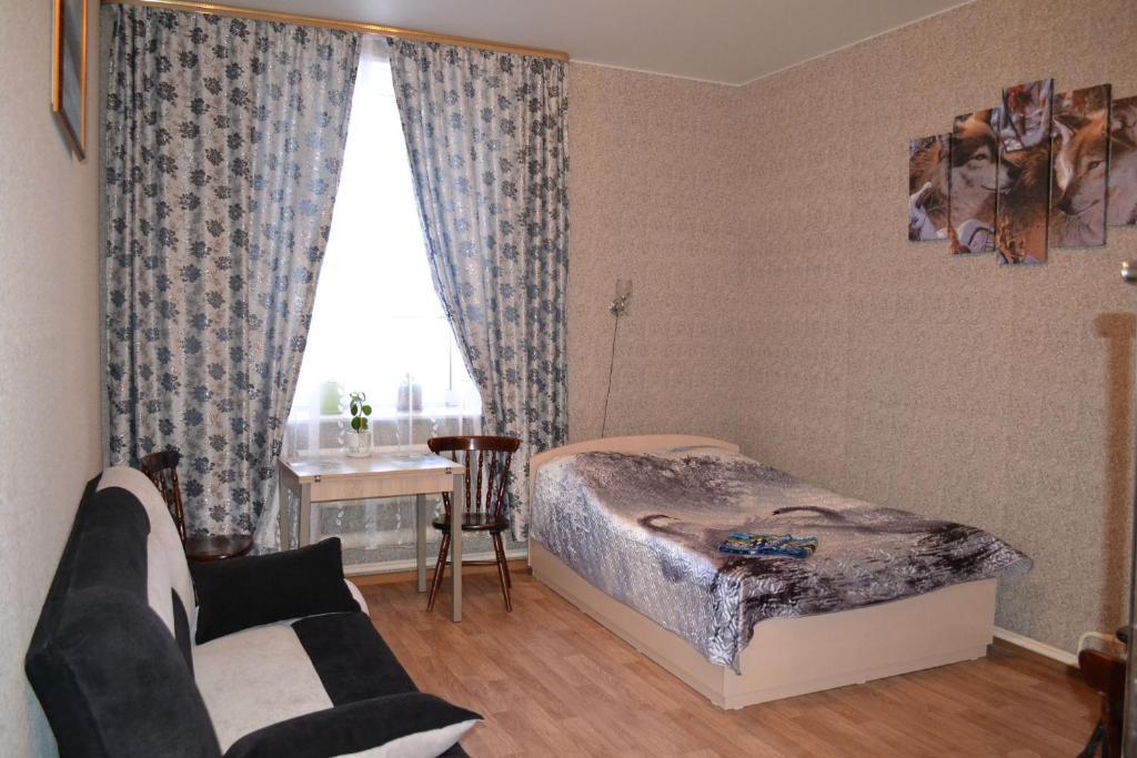 Кровать или кровати в номере Гостевой Дом «Соловей»