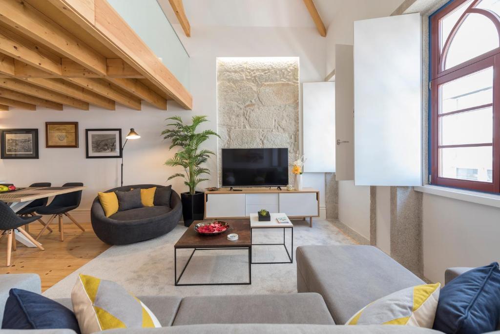 A seating area at LovelyStay-Modern Loft City Center