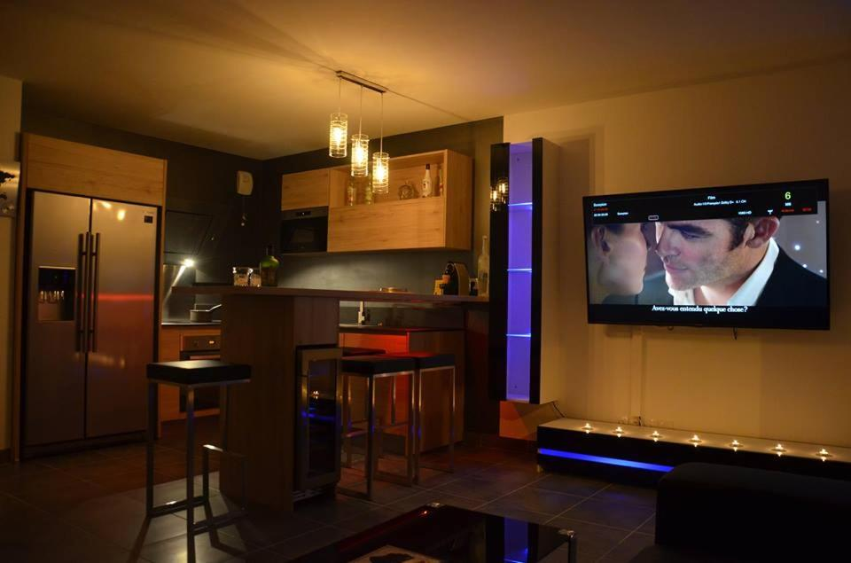 A television and/or entertainment center at DreamSuite.Aix