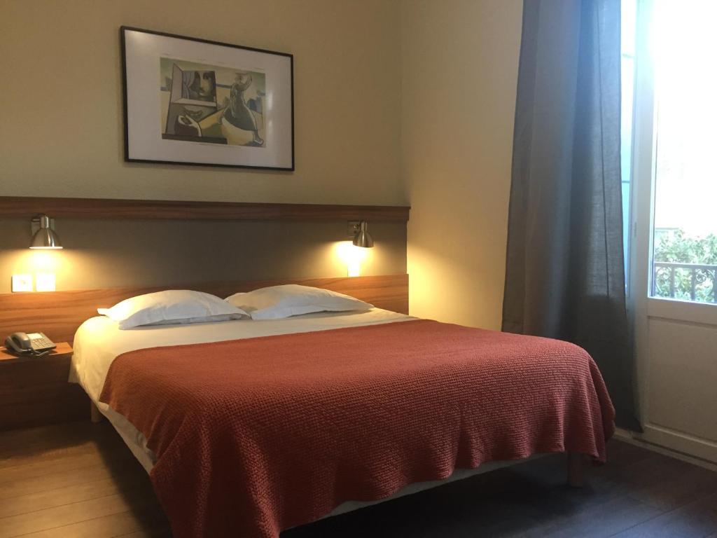 Krevet ili kreveti u jedinici u objektu Chambres Rue de la République