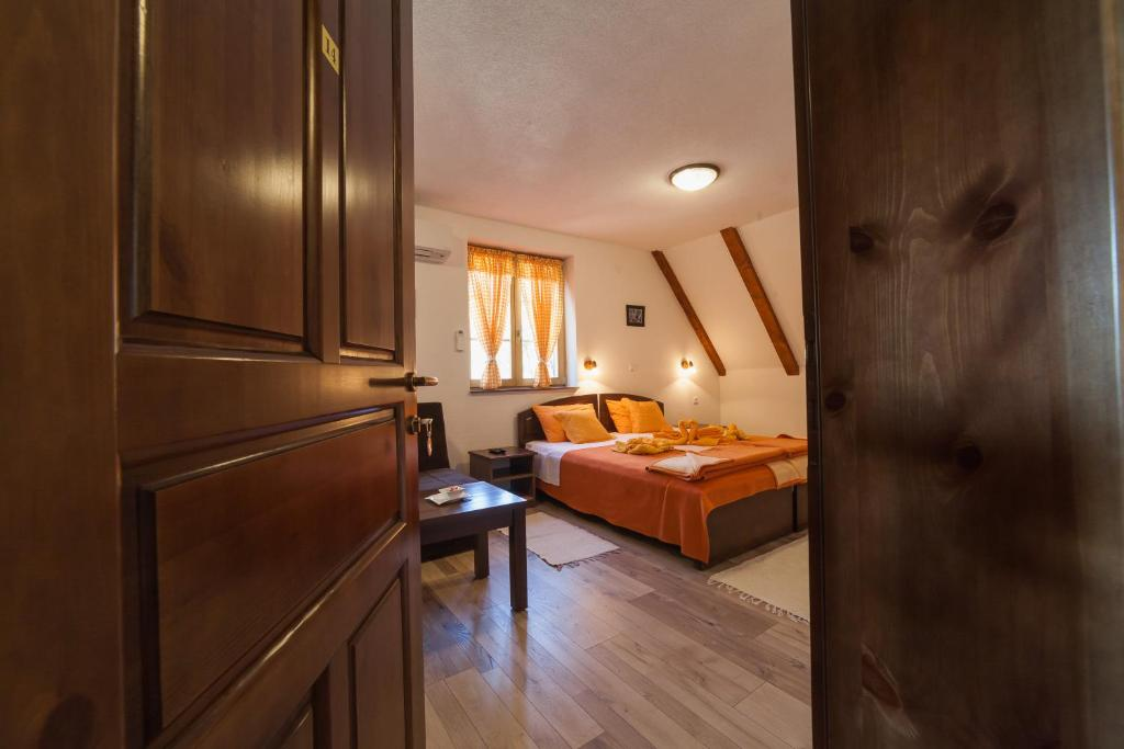 A bed or beds in a room at Guest House Rustico
