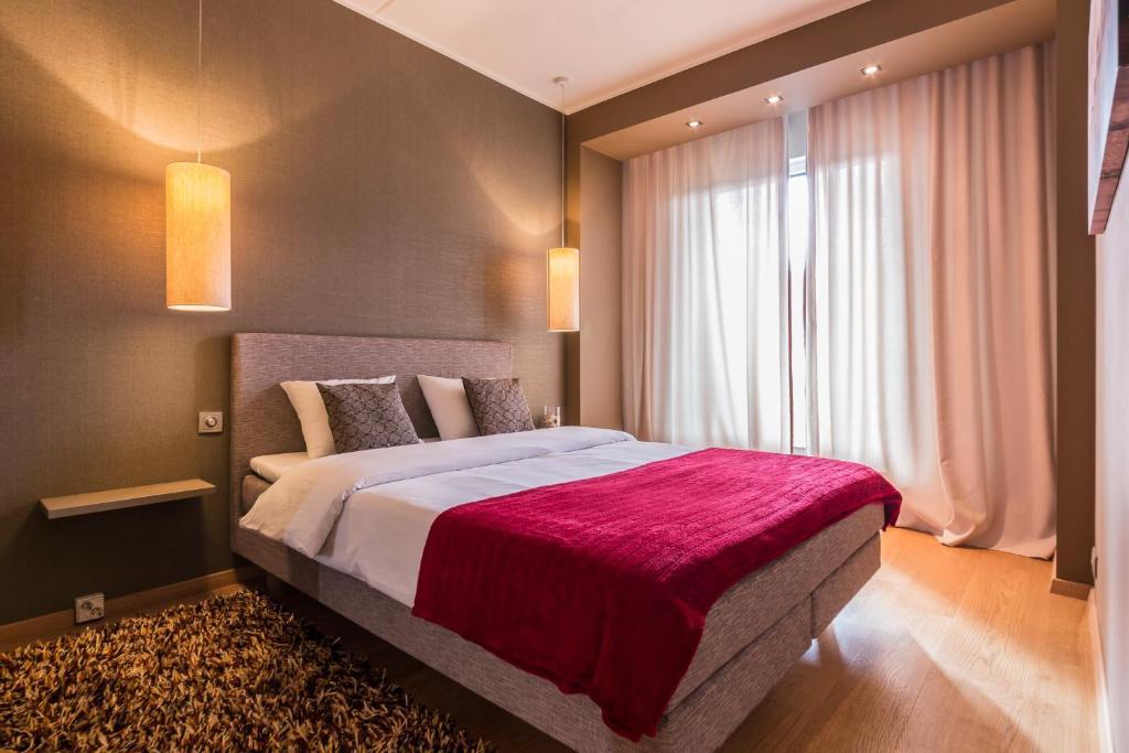 Кровать или кровати в номере Hilltop Apartments - City Centre Foorum