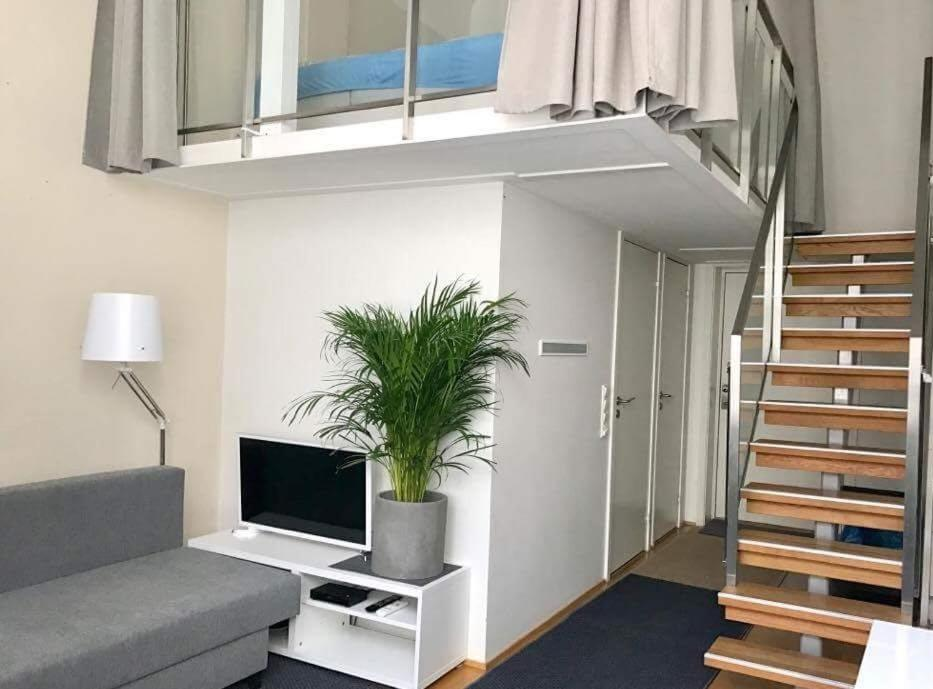 A television and/or entertainment centre at Oslo Main Street Apartment