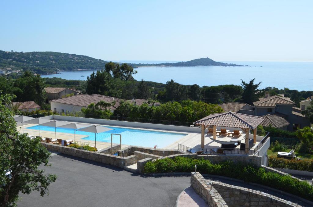 A view of the pool at Hôtel & Résidence Kallisté Porticcio or nearby