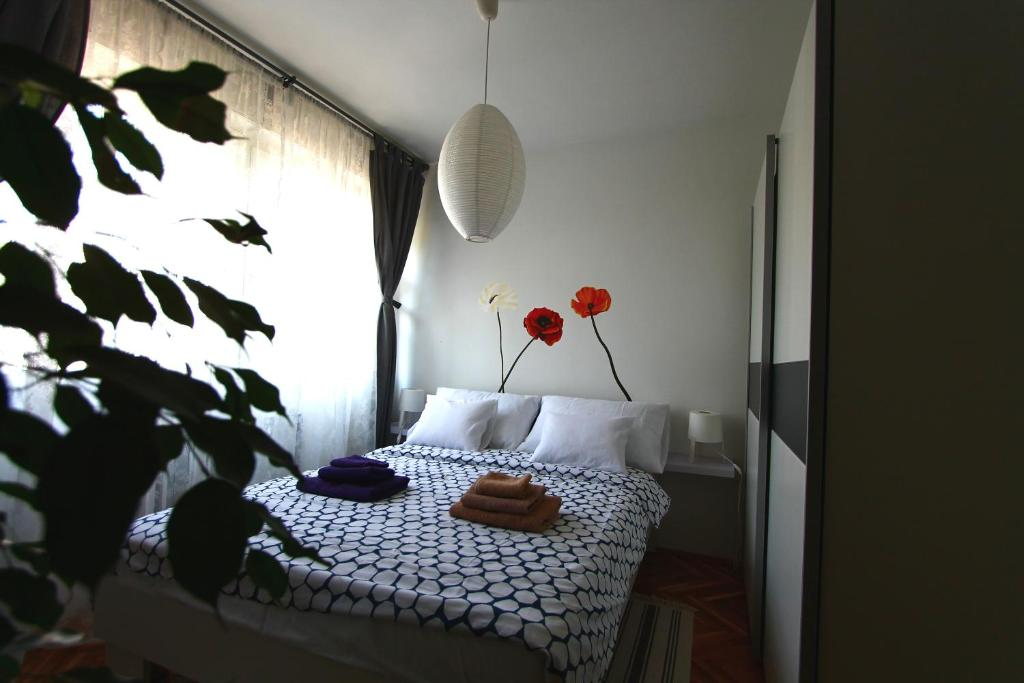 A bed or beds in a room at Apartment Melon