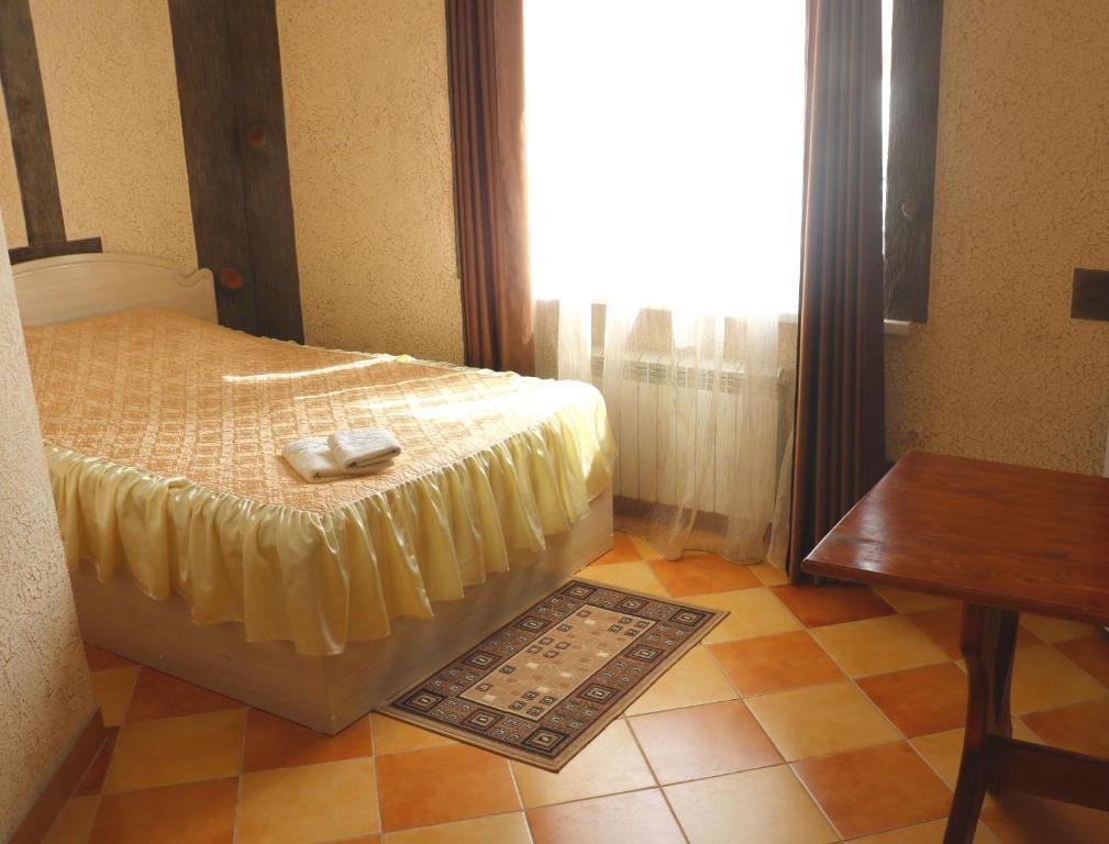 Кровать или кровати в номере Гостиный Двор №1
