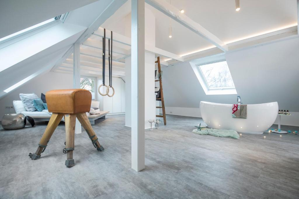 The fitness center and/or fitness facilities at Design-Studiowohnung Haegestrasse