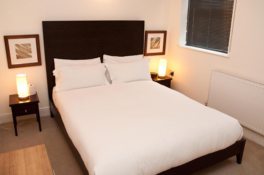 A bed or beds in a room at Clarendon Minories