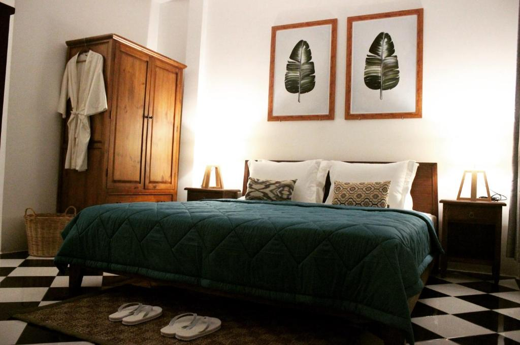 A bed or beds in a room at Villa Maison Con Dao Boutique Hotel