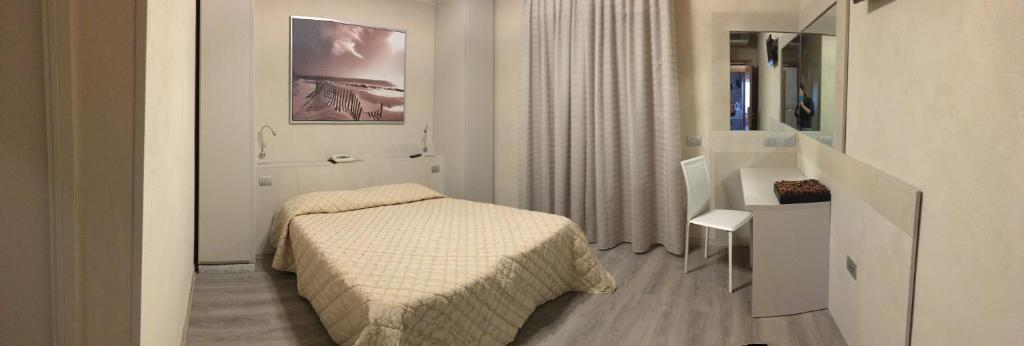 A bed or beds in a room at Hotel da Filie'