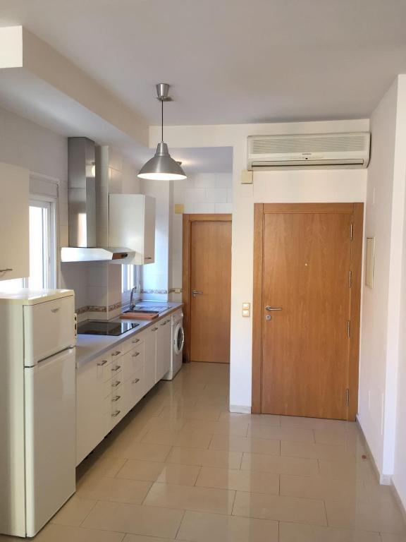 A kitchen or kitchenette at Apartmento Carbonero