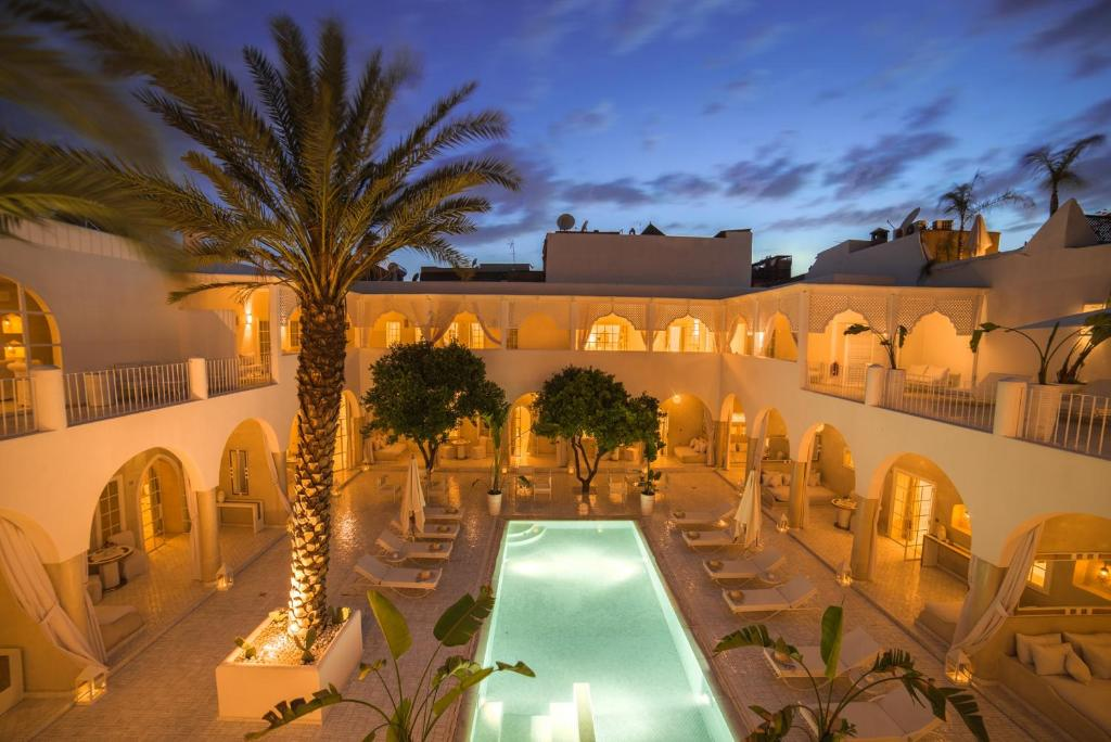 A view of the pool at Palais Blanc Riad or nearby
