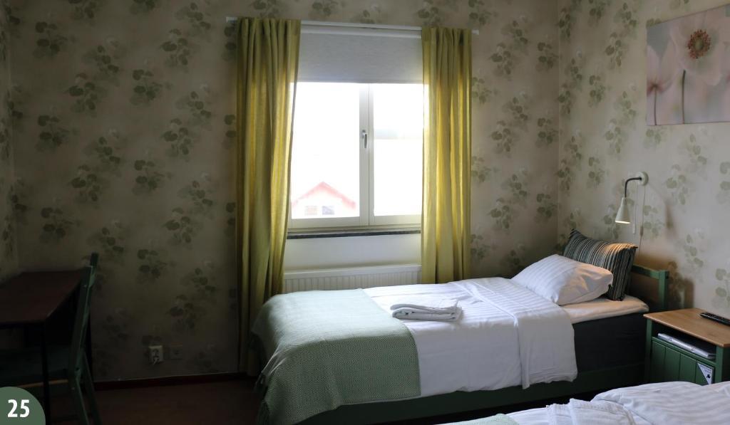 A bed or beds in a room at Svefi Vandrarhem - Hostel