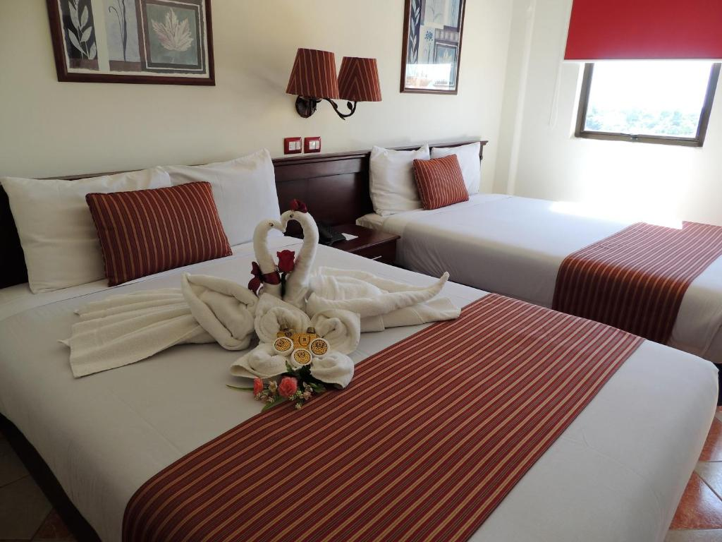A bed or beds in a room at Hotel Residencial