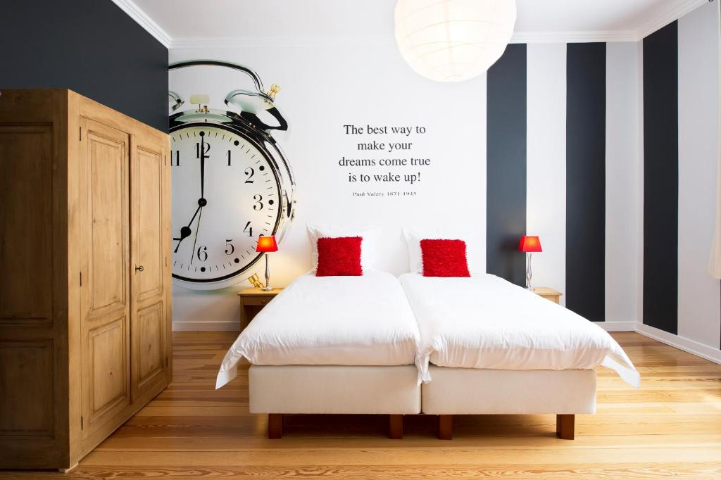 Un ou plusieurs lits dans un hébergement de l'établissement L'Auberge Du Notaire