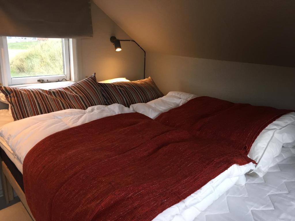 Een bed of bedden in een kamer bij Dancamps Nordsø Water Park