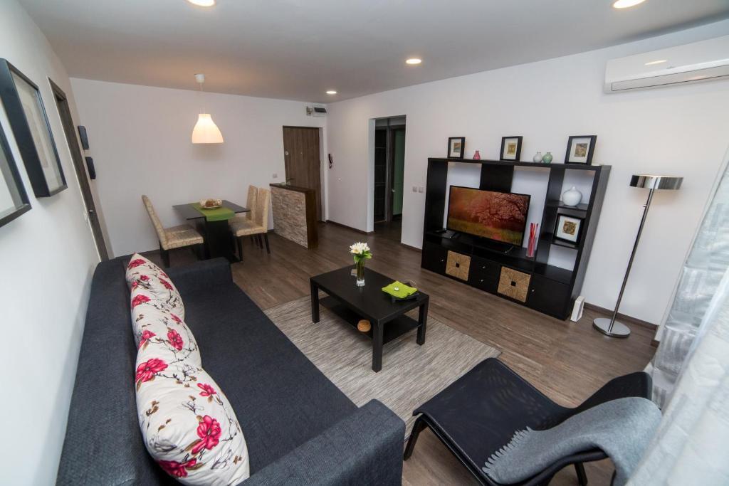 Area soggiorno di HighStyle Downtown Apartment