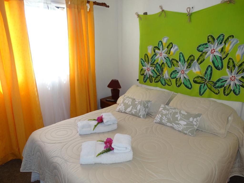 Cama o camas de una habitación en Hostal Sunset