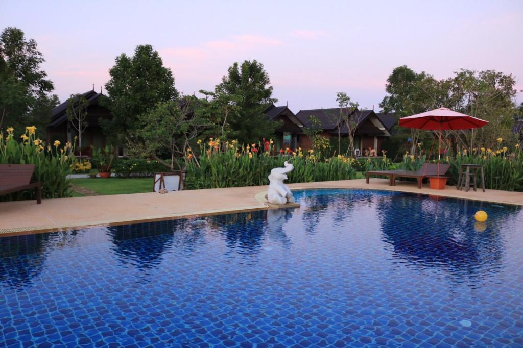 The swimming pool at or near Sawasdee Sukhothai Resort