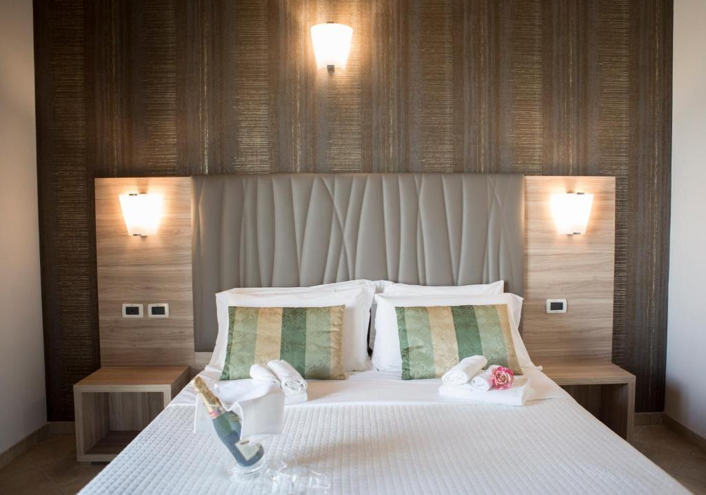 Кровать или кровати в номере Hotel Prestige
