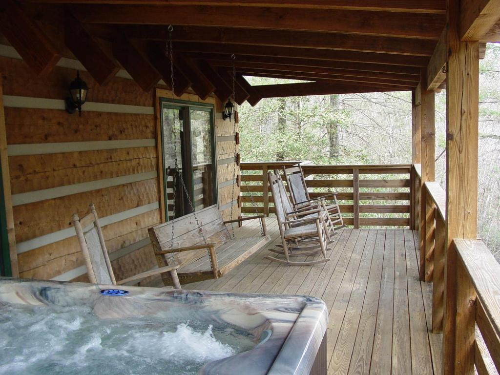 us vacation home com log this overlooking property secluded cabins creek bear image purlear hotel booking boone cabin gallery nc near of