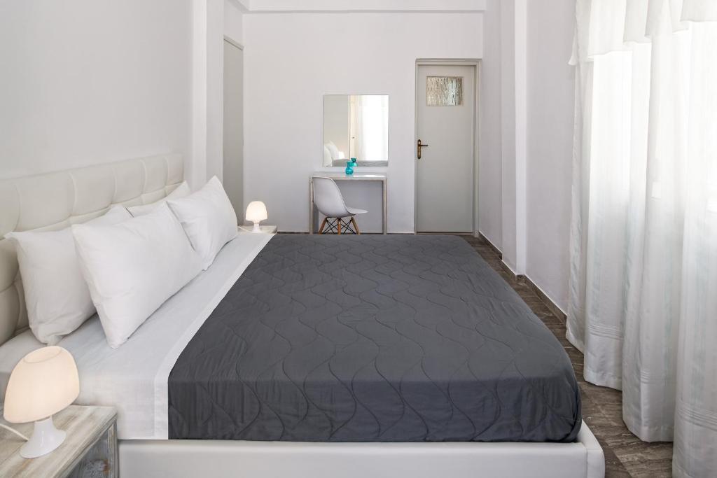 Letto o letti in una camera di Pension Kavallaris & Apartments
