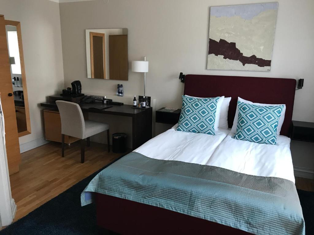 Säng eller sängar i ett rum på Hotel Riddargatan
