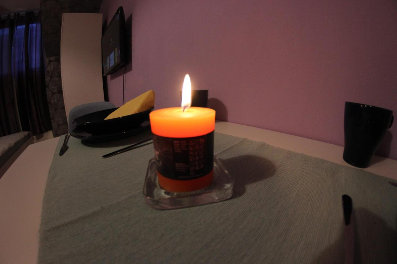 Cleaning the apartment with a church candle