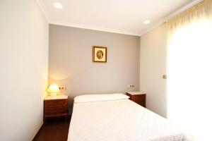 A bed or beds in a room at Villa Oliva16