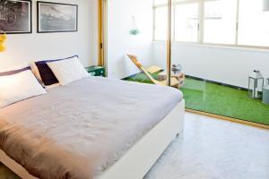 A bed or beds in a room at Apartamento en Santa Cruz