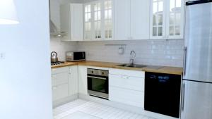 A kitchen or kitchenette at Collection Apartment - Milan