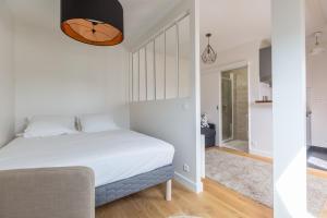 Un ou plusieurs lits dans un hébergement de l'établissement Assas-Vavin Appartements