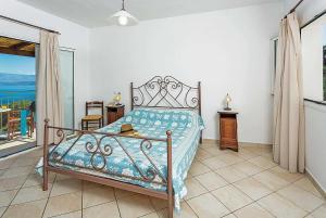 Een bed of bedden in een kamer bij Maria