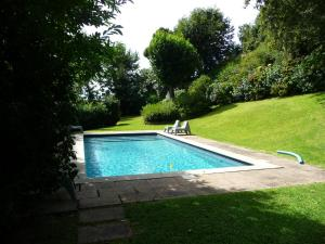 The swimming pool at or near Casa Castel'Rei