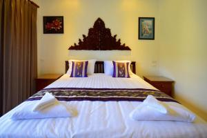 A bed or beds in a room at Siam Sunrise Seaview
