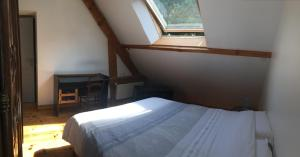A bed or beds in a room at Val St Germain