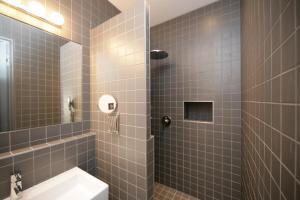 Ванная комната в Hôtel Particulier Appartements d'Hôtes