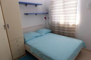 A bed or beds in a room at Apartment Penthouse Silvije