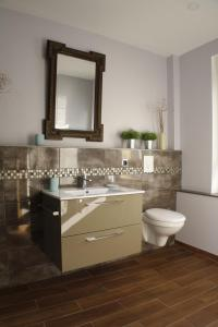 Salle de bains dans l'établissement L'ARBOGAST